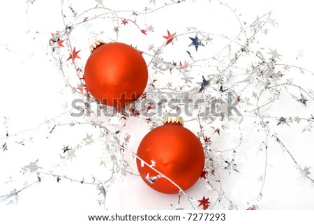 two red ornaments with stars isolated on a white background