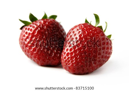 Two red strawberries Isolated close-up over white background