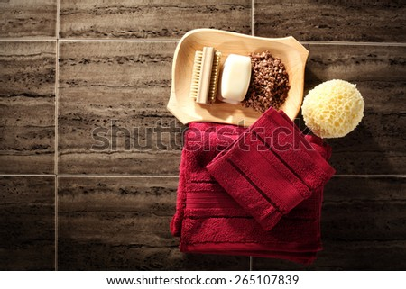 two red towels soap and brown floor