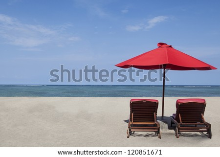 Two red umbrella beach and chairs in paradise island