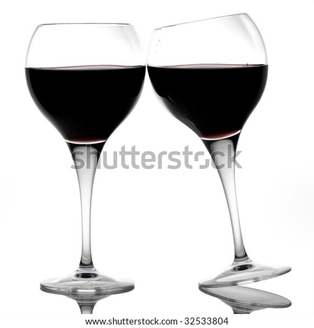 Two red wine glasses making a toast