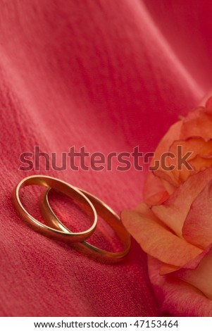 Two rings on red silk