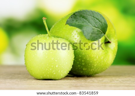 Two ripe apples on table outdoors