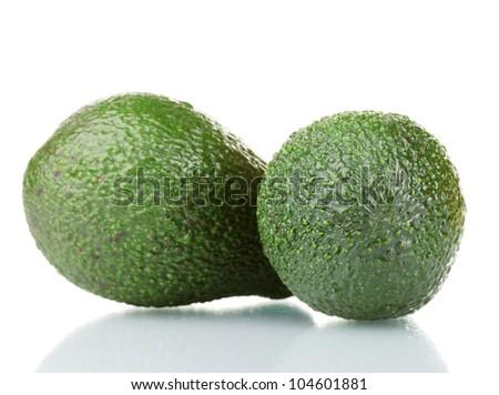 two ripe avocado fruits isolated on white