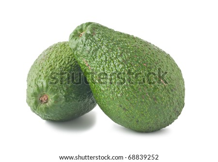 Two ripe avocados isolated on white background