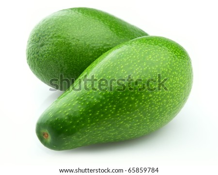 Two ripe avocados on a white background