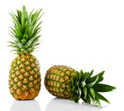 Two ripe fresh pineapples, isolated on white
