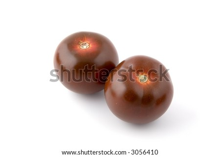 Two ripe Kumato tomatoes isolated on white