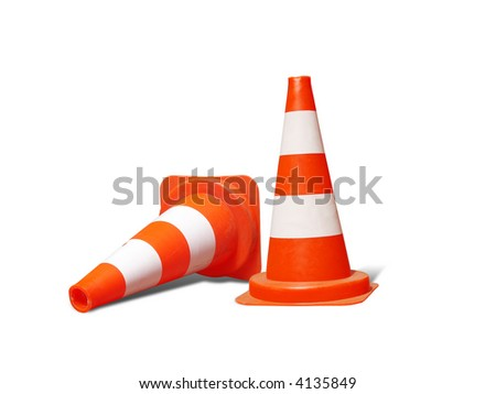 Two road warning cones, one down - isolated on white - stock photo