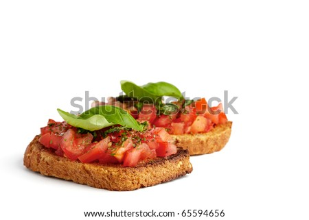 Two roasted breads with tomato, garlic and basil, isolated on white
