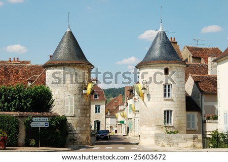 Two Romanesque towers in famous wine village Chablis, France.