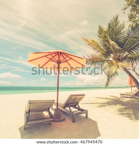Two romantic loungers under the palm trees in a tropical beach. Sun beds, white sandy relaxing beach. Luxury summer travel vacation holiday background concept. Maldives beach background. #467949470