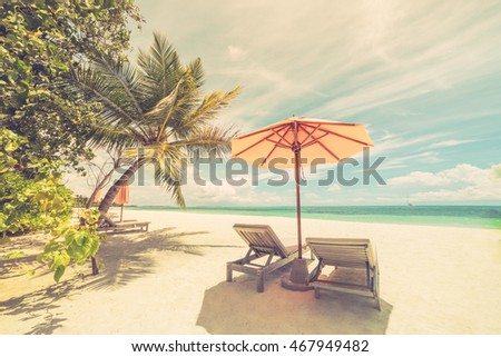 Two romantic loungers under the palm trees in a tropical beach. Sun beds, white sandy relaxing beach. Luxury summer travel vacation holiday background concept. Maldives beach background. #467949482