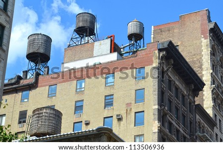 Two Rooftop water tanks on a New York apartment building