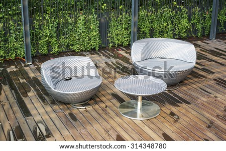 Two round grey fabric sofa and one grey round table on wooden floor #314348780