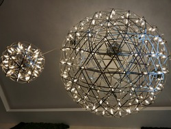 two round modern chandeliers like the earth and the moon or the sun and the moon!