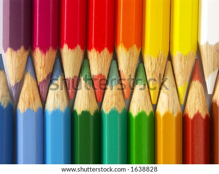 Two rows of colorful wooden crayons