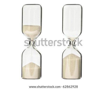 Two running hourglasses half full and empty isolated on white background