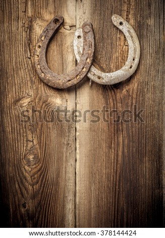 two rusty horseshoes hangs on...