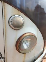 two rusty round car headlights