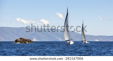 Two sailing boats yacht or sail regatta race on blue water Sea.