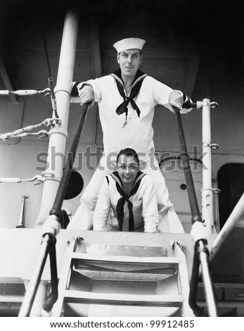Two sailors standing on a gangway