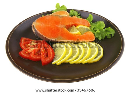 two salmon steak on dark dish over white