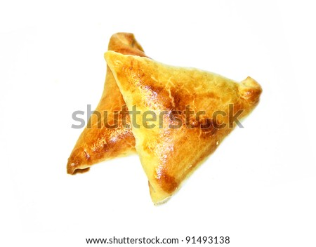 Two samosa triangles filled with chicken and beef mince