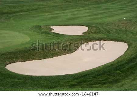 two sand traps on golf course