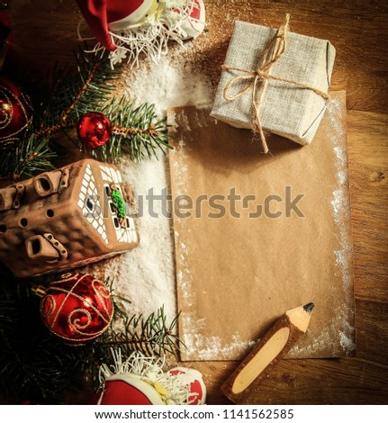 two Santa Claus and blank sheet for Christmas greetings . #1141562585