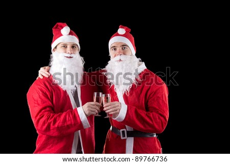 Two santa claus with champagne