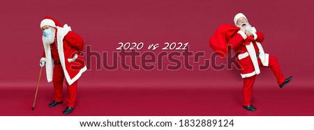 Two Santa Clauses as 2020 vs 2021 concept, banner. Ill sick sad Santa wearing face mask walking away with stick while new happy Santa wearing costume holding sack walking on Christmas red background.