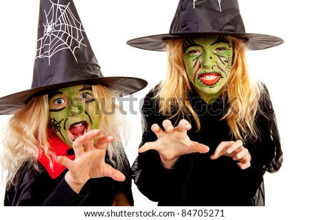 Two scary little green witches for Halloween over white background