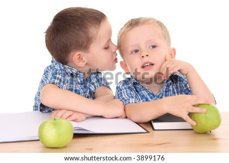two schoolboys at desk isolated on white