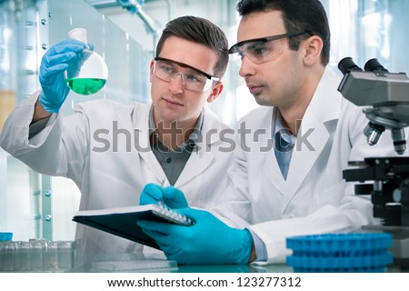 Two scientists  working in a research laboratory
