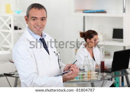Two scientists working in laboratory - stock photo