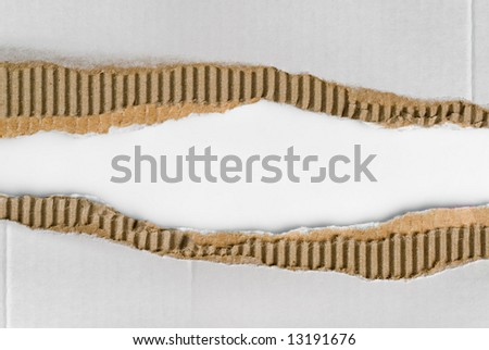 two scraps of torn corrugated cardboard