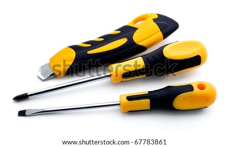 Two screw drivers and knife isolated on white background