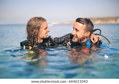 Two scuba diver having fun after dive #664611043