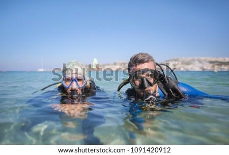 Two scuba divers in the sea #1091420912