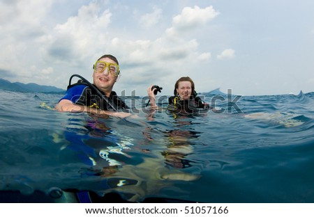 two scuba divers on surface #51057166