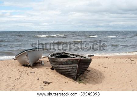 Two sea boats on the sea shore