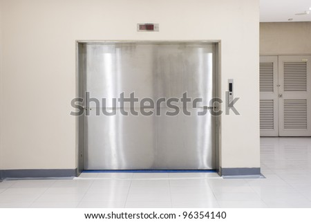 Two Section Slide-Up Door of Freight elevators in modern building. Can be office, school, hospital and Shopping plaza