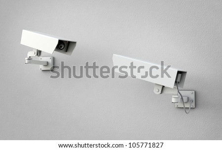 Two security cameras pointed at each other