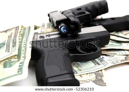 Two semi automatic handguns on a pile of United States twenty dollar bills. The rifling of the pistol barrel is visible.