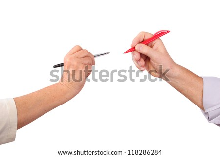 Two senior hands hold pens, isolated