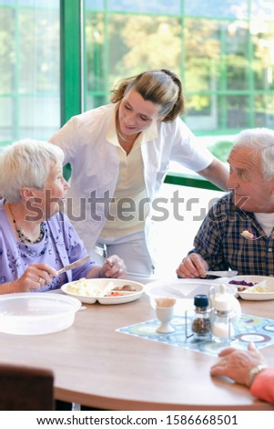 Two senior people having lunch in a retirement home