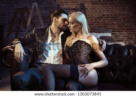 Two sensual lovers in a modern, stylish apartment