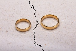 Two Separated Wedding Rings On Cracked Surface