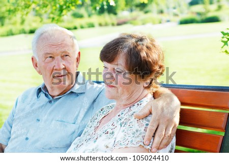 Two serene mature people together in park
